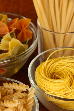 Different types of pasta on striped tablecloth